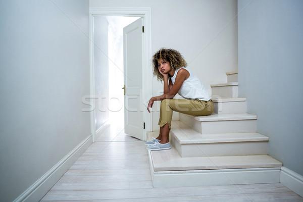 Tensed woman sitting on stairs Stock photo © wavebreak_media