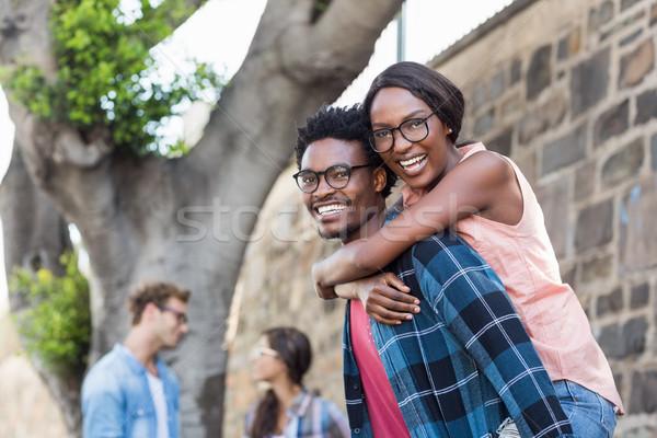 Fiatalember háton nő portré nő barát szeretet Stock fotó © wavebreak_media