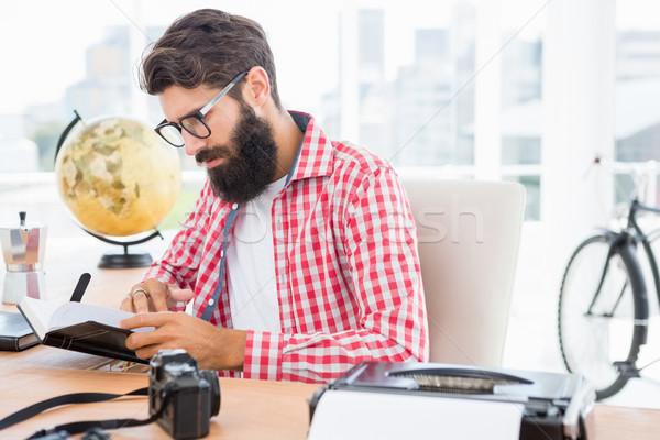 Hipster man reading his notes Stock photo © wavebreak_media