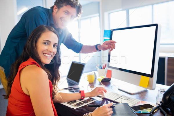Colleagues using a graphic pad Stock photo © wavebreak_media