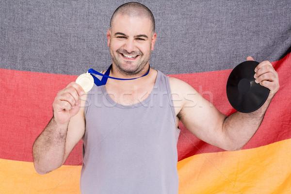 Atléta aranyérem Németország zászló férfi fém Stock fotó © wavebreak_media