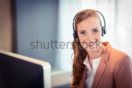 Businesswoman talking on headphones Stock photo © wavebreak_media