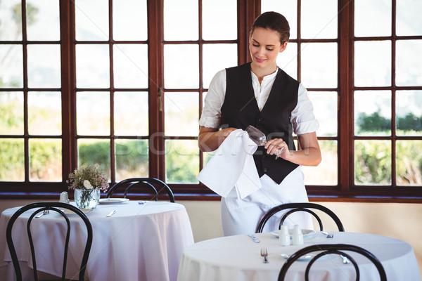 Waitress cleaning wineglass  Stock photo © wavebreak_media