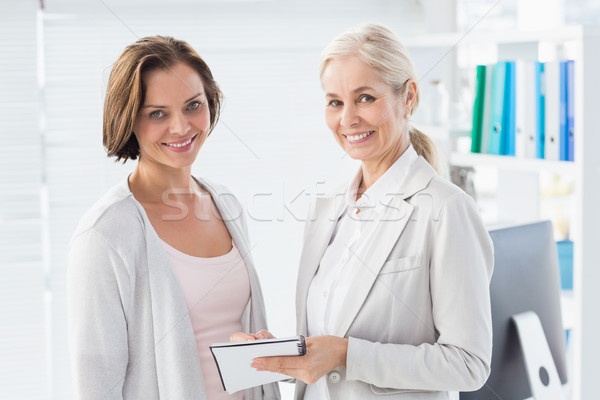 Smiling woman with therapist Stock photo © wavebreak_media