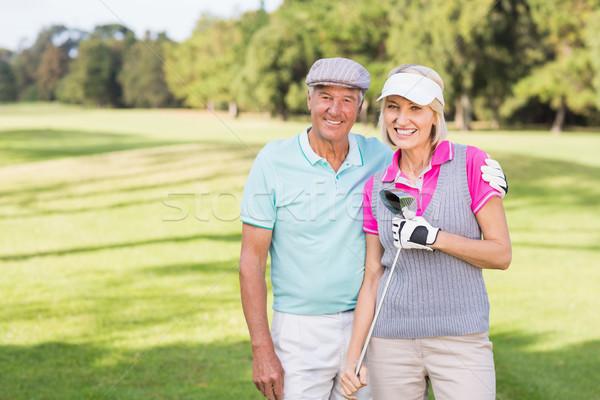 Sorridente maduro casal em pé campo de golfe retrato Foto stock © wavebreak_media