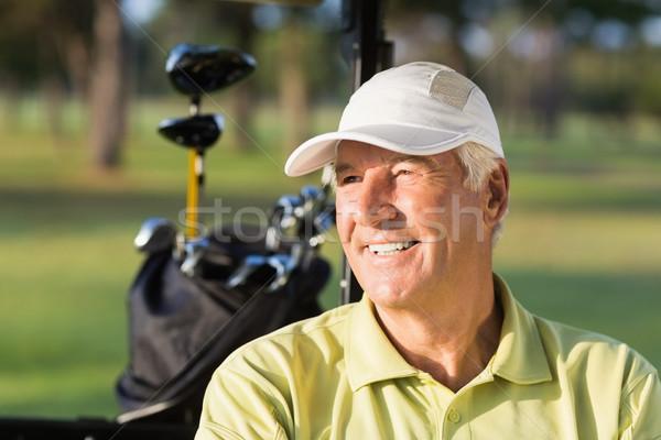 Primer plano sonriendo golfista hombre sesión golf Foto stock © wavebreak_media