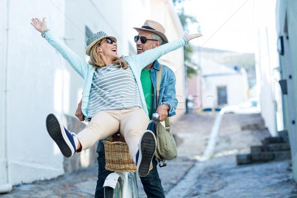Couple enjoying while riding bicycle Stock photo © wavebreak_media