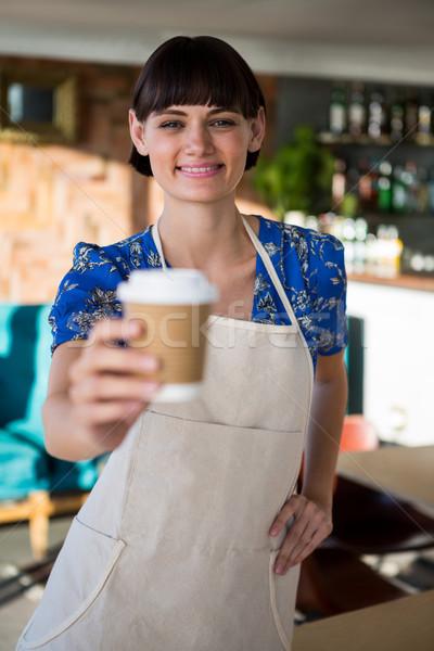 笑みを浮かべて ウエートレス 提供すること カップ コーヒー 肖像 ストックフォト © wavebreak_media