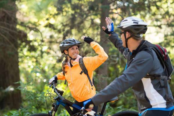 пару high five верховая езда велосипед лес Сток-фото © wavebreak_media