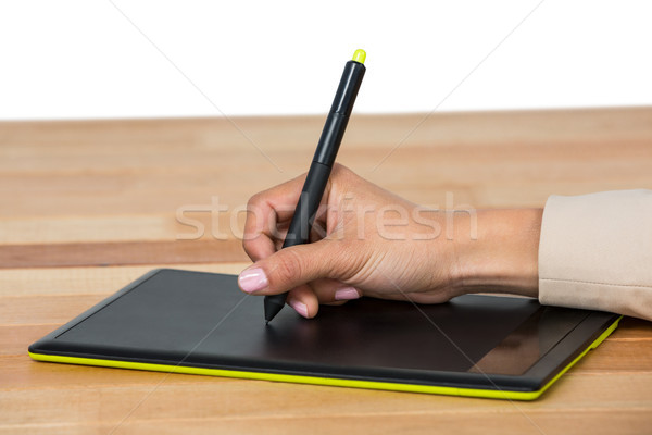 Hand of graphic designer using graphic tablet Stock photo © wavebreak_media