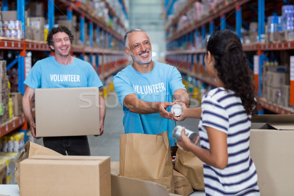 Három önkéntesek csomagol kartondoboz raktár boldog Stock fotó © wavebreak_media