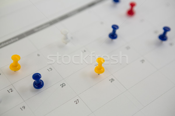 Close-up of blue, red and yellow push pin Stock photo © wavebreak_media