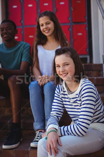 Portré diákok ül lépcsőház iskola lány Stock fotó © wavebreak_media