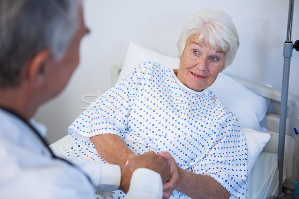 Doctor examining senior patient in ward Stock photo © wavebreak_media