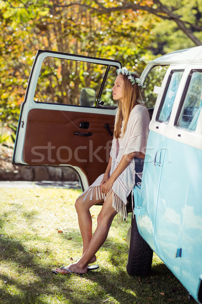 Woman with flower wreath sitting in campervan Stock photo © wavebreak_media