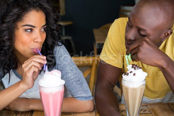 Loving couple having milkshakes at table in coffee shop Stock photo © wavebreak_media