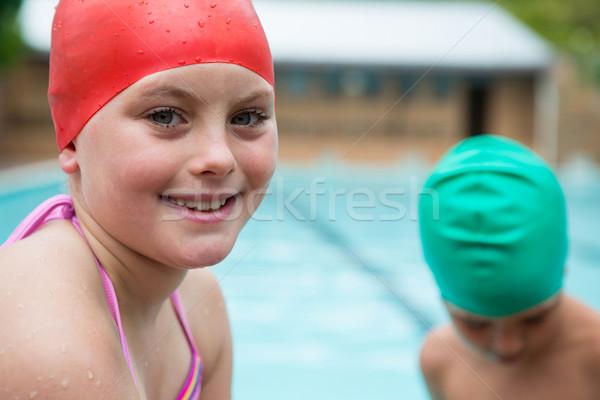 Smiling girl with swim cap near poolside Stock photo © wavebreak_media