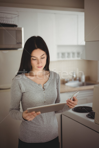 Woman looking at tablet computer Stock photo © wavebreak_media