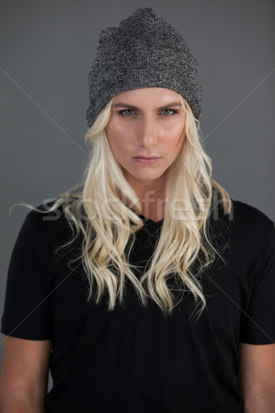 Portrait of beautiful transgender woman wearing knit hat Stock photo © wavebreak_media