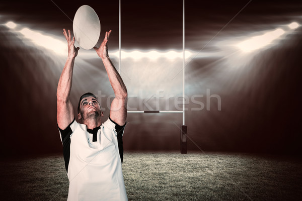 Composite image of rugby player catching the ball Stock photo © wavebreak_media