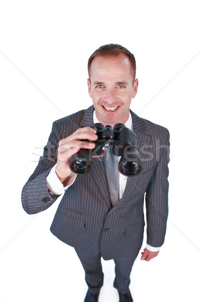 Stock photo: High angle of a businessman holding binoculars