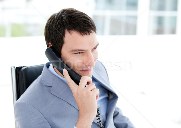 Charming young businessman talking on phone Stock photo © wavebreak_media