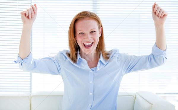 Nice business woman punching the air Stock photo © wavebreak_media