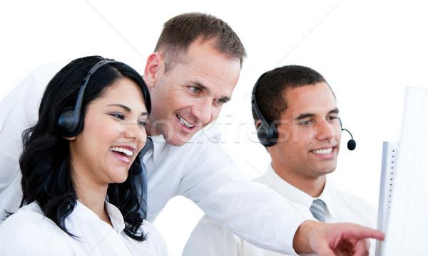 Uśmiechnięty zespół firmy pracy komputera biały telefonu Zdjęcia stock © wavebreak_media