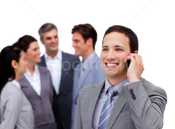 красивый бизнесмен телефон Постоянный отдельно команда Сток-фото © wavebreak_media