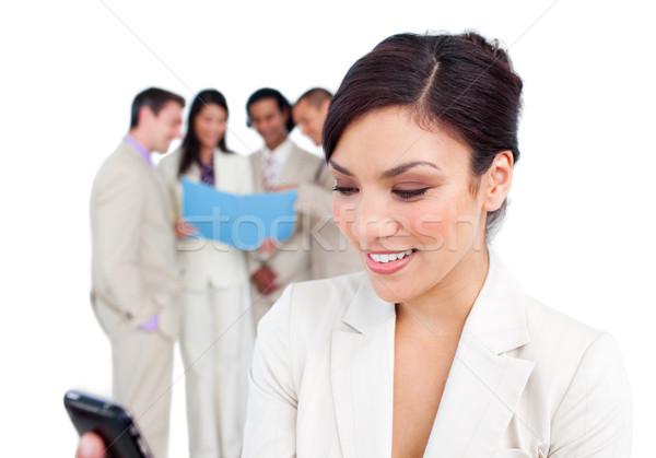 Portrait of a pretty businesswoman sending a text Stock photo © wavebreak_media