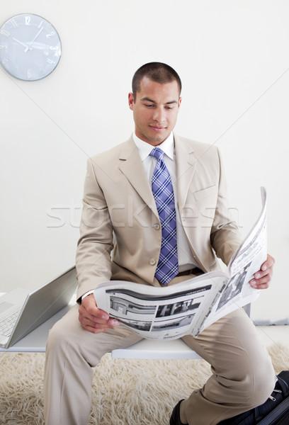 Confident manager reading a newspaper Stock photo © wavebreak_media