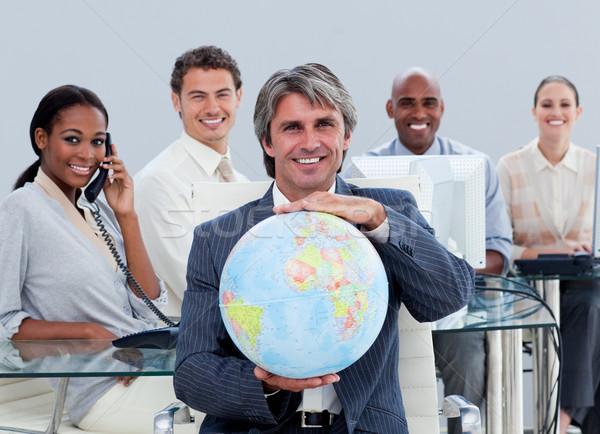 üzleti csapat munka mutat földgömb iroda telefon Stock fotó © wavebreak_media