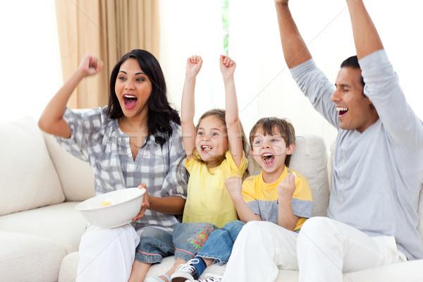 Animated family watching TV on sofa Stock photo © wavebreak_media