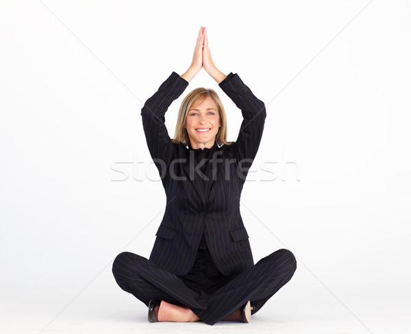 Businesswoman resting on floor doing yoga Stock photo © wavebreak_media