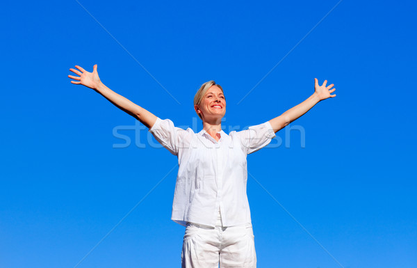 Happy woman feeling free with open arms Stock photo © wavebreak_media