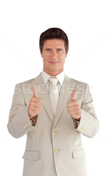 Positive businessman making a thumb-up isolated on a white background Stock photo © wavebreak_media