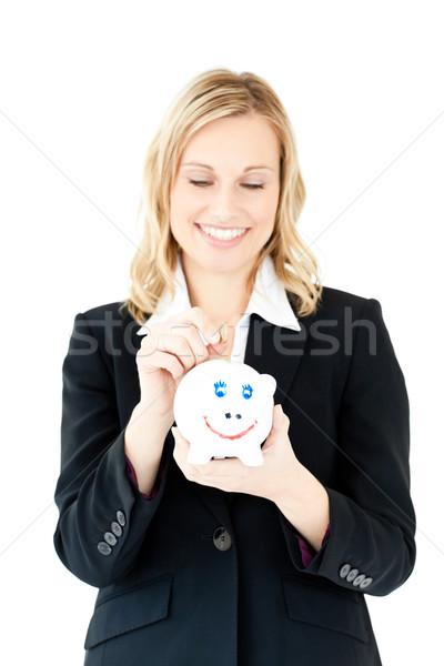 Woman putting money in a piggybank Stock photo © wavebreak_media