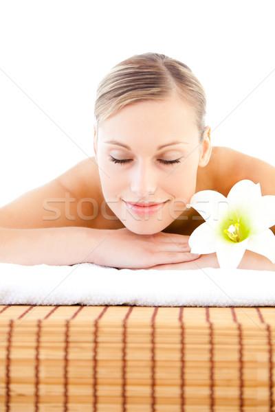 Közelkép elragadtatott nő masszázs asztal virág Stock fotó © wavebreak_media