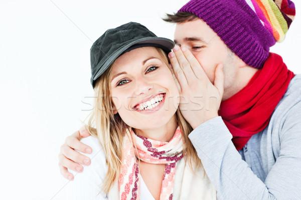 Fiatalember kalap suttog valami női barát Stock fotó © wavebreak_media