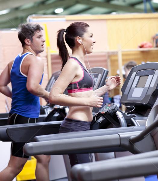 Gezonde paar lopen tredmolen sport centrum Stockfoto © wavebreak_media