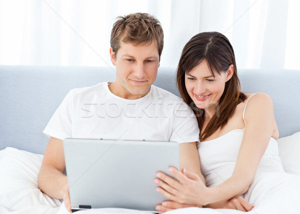 Young couple watching videos on their computer at home Stock photo © wavebreak_media
