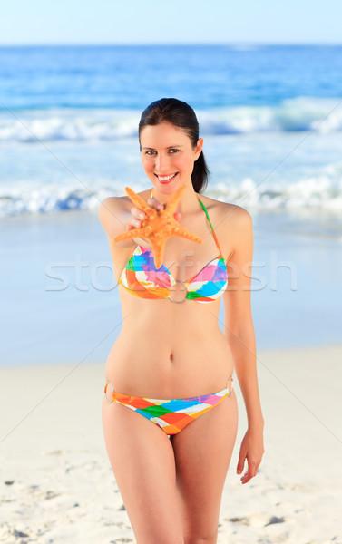 Pretty woman with a starfish Stock photo © wavebreak_media