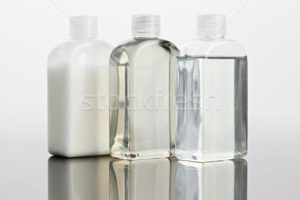 Close up of glass phials on a mirror Stock photo © wavebreak_media