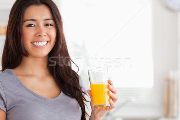 Jól kinéző nő tart üveg narancslé áll Stock fotó © wavebreak_media