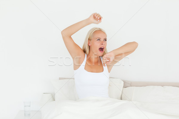 Vrouw omhoog slaapkamer hand gezicht gelukkig Stockfoto © wavebreak_media
