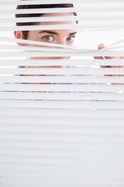 Kíváncsi nő ki ablak iroda arc Stock fotó © wavebreak_media