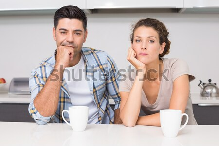 Worn out couple drinking coffee in a kitchen Stock photo © wavebreak_media