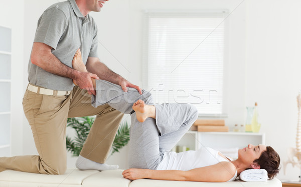 A chiropractor is stretching a woman's leg Stock photo © wavebreak_media