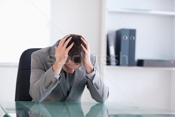 Businessman after failed negotiation sitting behind a table Stock photo © wavebreak_media