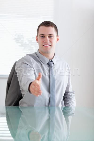 бизнесмен приветствие переговоры партнера сидят Сток-фото © wavebreak_media